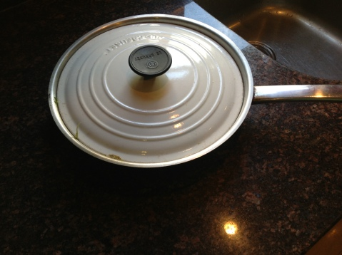 LId is so stuck in the pan. Tried to tap it, knock it, pry it and turned it upside down under running water. NADA